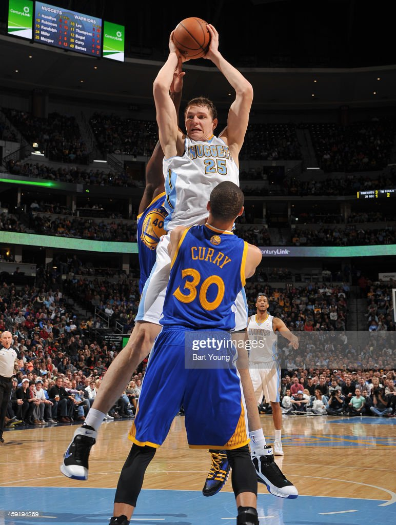 <a gi-track='captionPersonalityLinkClicked' href=/galleries/search?phrase=Timofey+Mozgov&family=editorial&specificpeople=3949705 ng-click='$event.stopPropagation()'>Timofey Mozgov</a> #25 of the Denver Nuggets grabs a rebound against the Golden State Warriors on December 23, 2013 at the Pepsi Center in Denver, Colorado.
