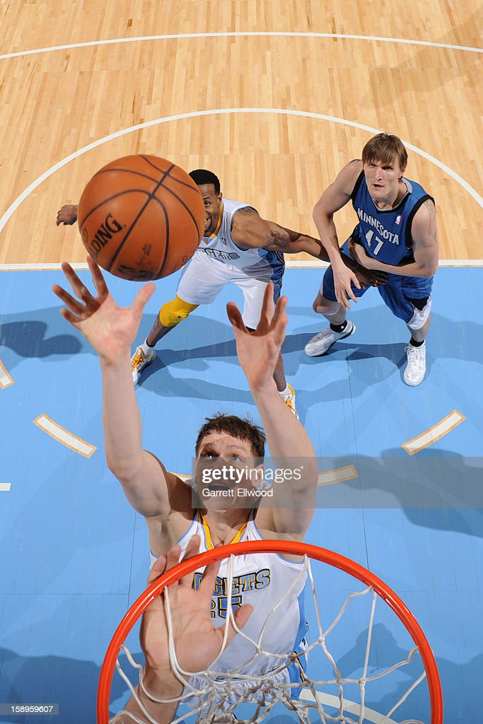 <a gi-track='captionPersonalityLinkClicked' href=/galleries/search?phrase=Timofey+Mozgov&family=editorial&specificpeople=3949705 ng-click='$event.stopPropagation()'>Timofey Mozgov</a> #25 of the Denver Nuggets grabs the rebound against the Minnesota Timberwolves on January 3, 2013 at the Pepsi Center in Denver, Colorado.