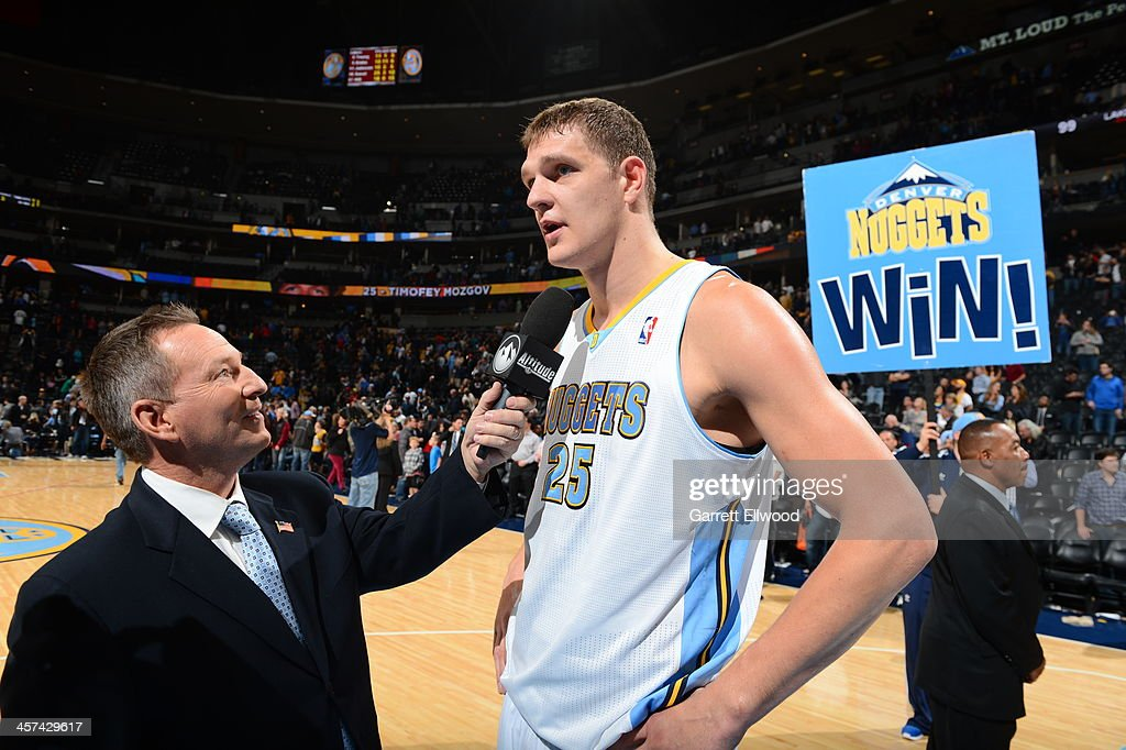 Timofey Mozgov #25 of the Denver Nuggets is interviewed after the game against the Los Angeles Lakers on November 13, 2013 at the Pepsi Center in Denver, Colorado.
