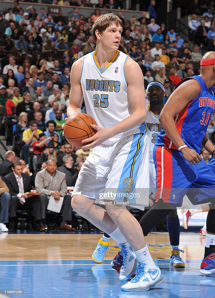 Timofey Mozgov #25 of the Denver Nuggets pulls down a rebound against the Detroit Pistons on March 12, 2011 at the Pepsi Center in Denver, Colorado.
