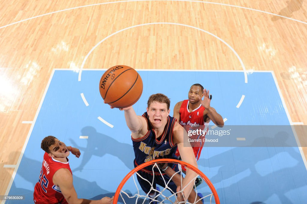 <a gi-track='captionPersonalityLinkClicked' href=/galleries/search?phrase=Timofey+Mozgov&family=editorial&specificpeople=3949705 ng-click='$event.stopPropagation()'>Timofey Mozgov</a> #25 of the Denver Nuggets shoots the ball against the Los Angeles Clippers on March 17, 2014 at the Pepsi Center in Denver, Colorado.