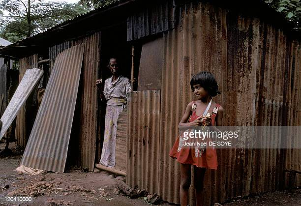 Timor Leste in December 2000 Woman and child in front of their house in Titilari village around Los Palos An Indonesian province which gained...