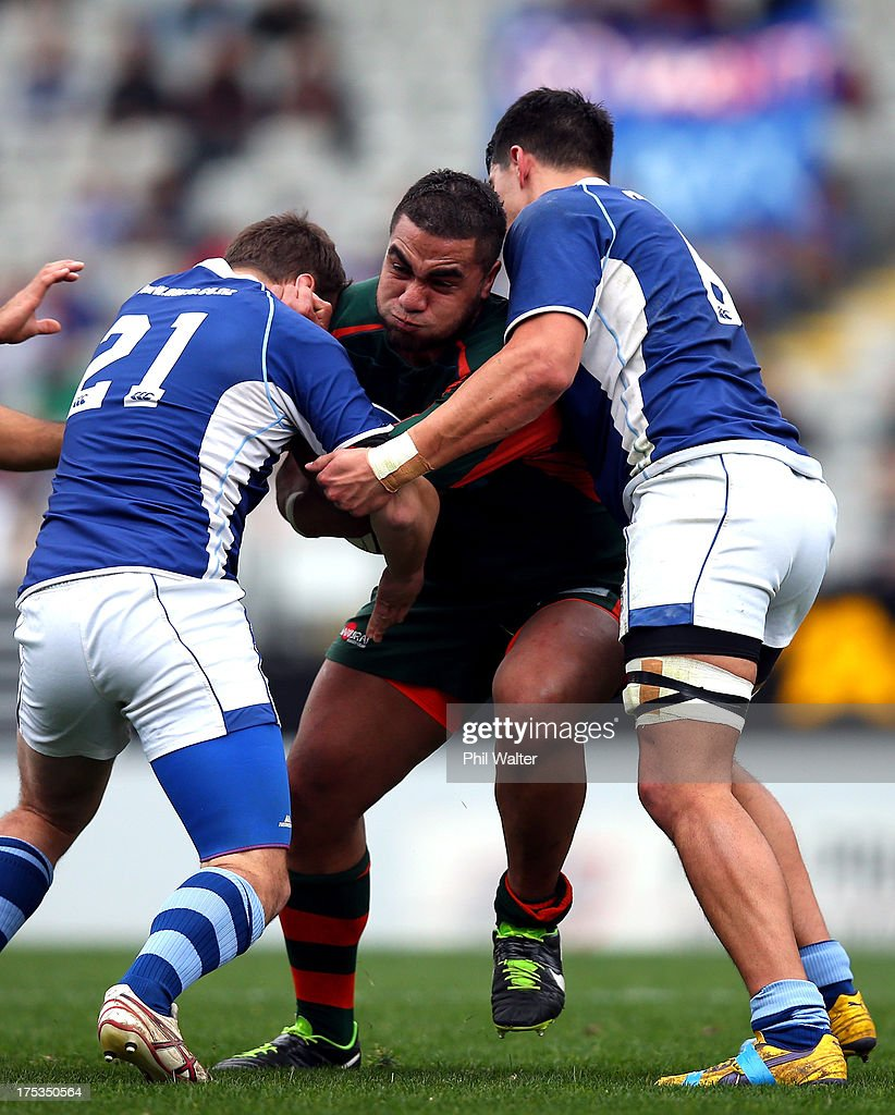 Timote Militoni of Pakuranga is tackled during the Gallaher Shield Final match between Pakuranga and University at Eden Park on August 3, 2013 in Auckland, New Zealand.