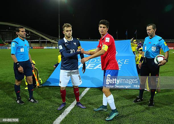Timothe Cognat of France and Luis Hernandez of Costa Rica shake hands after the France v Costa Rica Round of 16 FIFA U17 World Cup Chile 2015 match...