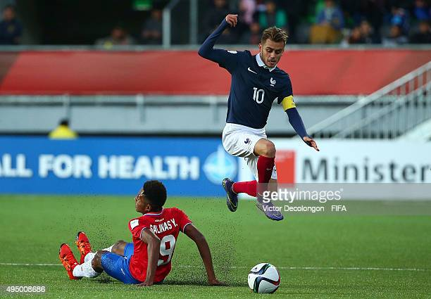 Timothe Cognat of France plays the ball past Yostin Salinas of Costa Rica during the France v Costa Rica Round of 16 FIFA U17 World Cup Chile 2015...