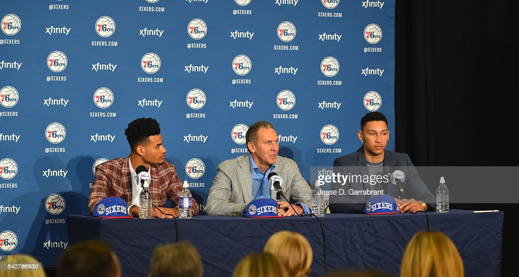 <a gi-track='captionPersonalityLinkClicked' href=/galleries/search?phrase=Timothe+Luwawu&family=editorial&specificpeople=13900576 ng-click='$event.stopPropagation()'>Timothe Luwawu</a> #20 , President of Operations Brian Colangelo and <a gi-track='captionPersonalityLinkClicked' href=/galleries/search?phrase=Ben+Simmons+-+Basketball+Player&family=editorial&specificpeople=13900541 ng-click='$event.stopPropagation()'>Ben Simmons</a> #25 of the Philadelphia 76ers address the media at the Philadelphia College of Osteopathic Medicine on June 7, 2015 in Philadelphia, Pennsylvania