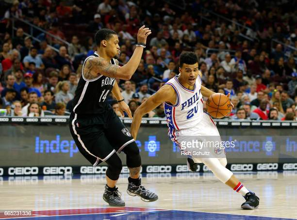 Timothe LuwawuCabarrot of the Philadelphia 76ers drives to the basket as KJ McDaniels of the Brooklyn Nets defends in the first half during an NBA...