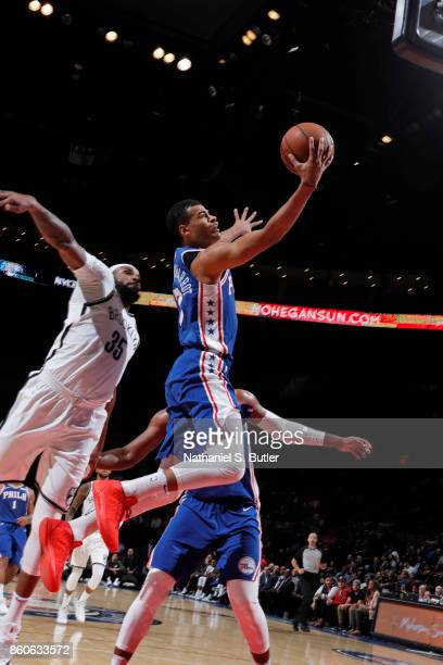 Timothe LuwawuCabarrot of the Philadelphia 76ers drives to the basket against the Brooklyn Nets on October 11 2017 at Nassau Veterans Memorial...