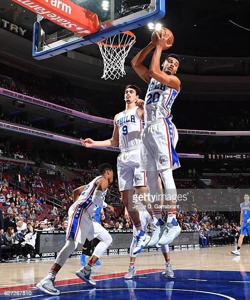Timothe LuwawuCabarrot of the Philadelphia 76ers grabs the rebound against the Orlando Magic at Wells Fargo Center on December 2 2016 in Philadelphia...