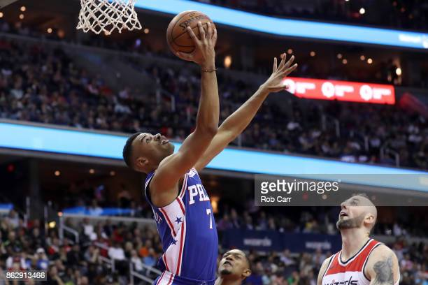 Timothe LuwawuCabarrot of the Philadelphia 76ers puts up a shot in front of Marcin Gortat of the Washington Wizards in the first half at Capital One...