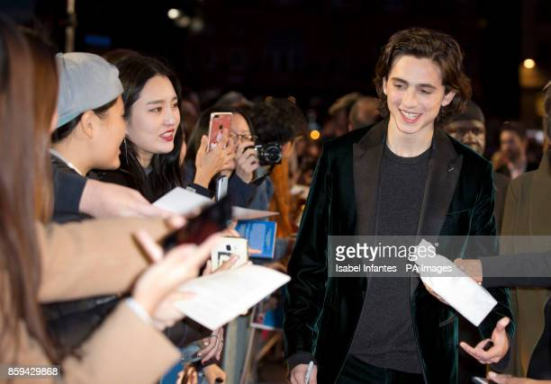 Timothee Chalamet with fans as he attends the premiere of Call Me By My Name as part of the BFI London Film Festival at Odeon Leicester Square London