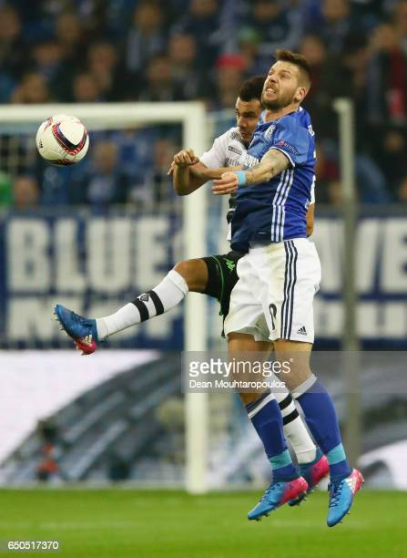 Timothee Kolodziejczak of Borussia Moenchengladbach and Guido Burgstaller of Schalke jump for the ball during the UEFA Europa League Round of 16...