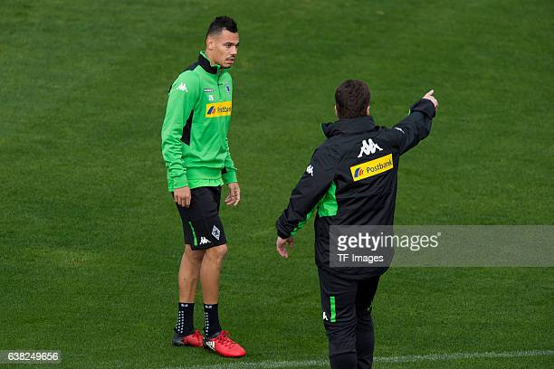 Timothee Kolodziejczak of Borussia Moenchengladbach and Head couch Dieter Hecking of Borussia Moenchengladbach during a Training Session at Borussia...