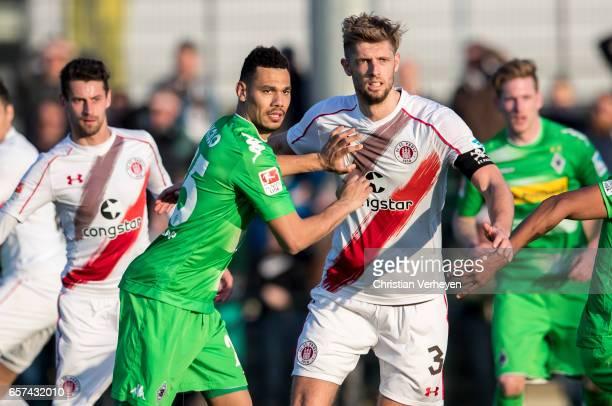 Timothee Kolodziejczak of Borussia Moenchengladbach and Lasse Sobiech of FC St Pauli during the Friendly Match between Borussia Moenchengladbach and...