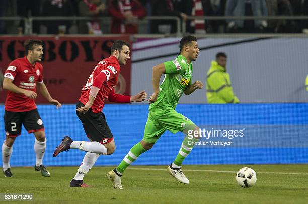Timothee Kolodziejczak of Borussia Moenchengladbach is chased by Levin Oeztunali of FSV Mainz 05 during the Telekom Cup match between Borussia...