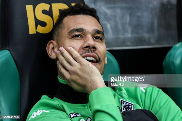 Timothee Kolodziejczak of Moenchengladbach sits on the bench prior the Bundesliga match between Borussia Moenchengladbach and Bayern Muenchen at...