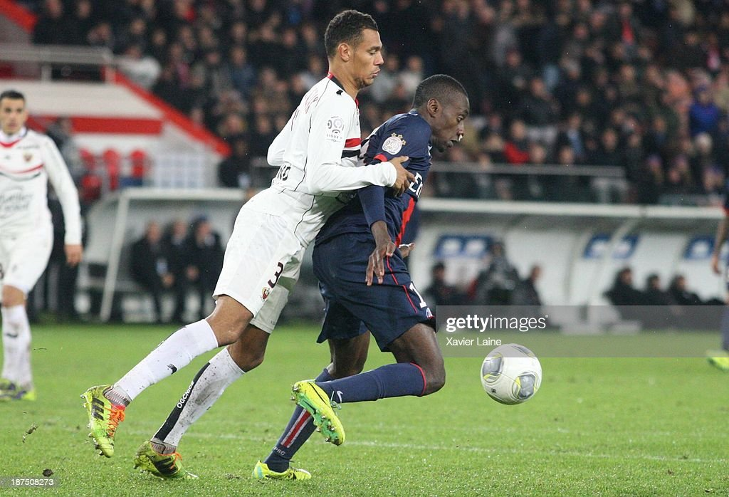 Timothee Kolodziejczak of OGC Nice and <a gi-track='captionPersonalityLinkClicked' href=/galleries/search?phrase=Blaise+Matuidi&family=editorial&specificpeople=801779 ng-click='$event.stopPropagation()'>Blaise Matuidi</a> of Paris Saint-Germain compete for the ball during the French Ligue 1 between Paris Saint-Germain FC and OGC Nice at Parc Des Princes on November 09, 2013 in Paris, France.