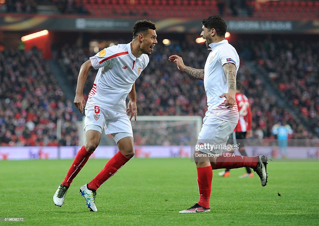 Timothee Kolodziejczak (L) of Sevilla FC celebrates after scoring his team's opening goal during the UEFA Europa League Quarter Final First Leg match between Athletic Bilbao and Sevilla at San Mames stadium on April 7, 2016 in Bilbao, Spain.