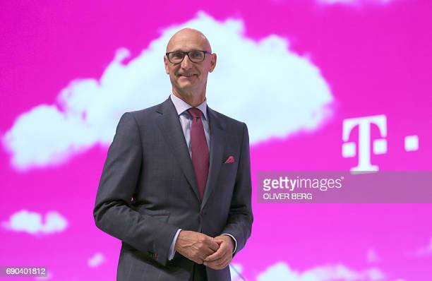 Timotheus Hoettges chairman of German telecommunications giant Deutsche Telekom poses during his company's annual general meeting in Cologne western...