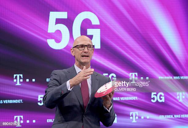 Timotheus Hoettges chairman of German telecommunications giant Deutsche Telekom presents the next telecommunications standard the 5th generation...