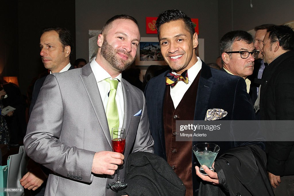 Timothy Bouldry and Hugo Chavez attend the ACRIA annual holiday dinner benefiting AIDS research on December 11, 2013 in New York City.