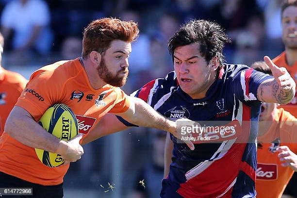 Timothy Buchanan of the Country Eagles is tackled by Tyrel Lomax of Melbourne Rising during the NRC Semi Final match between the NSW Country Eagles...