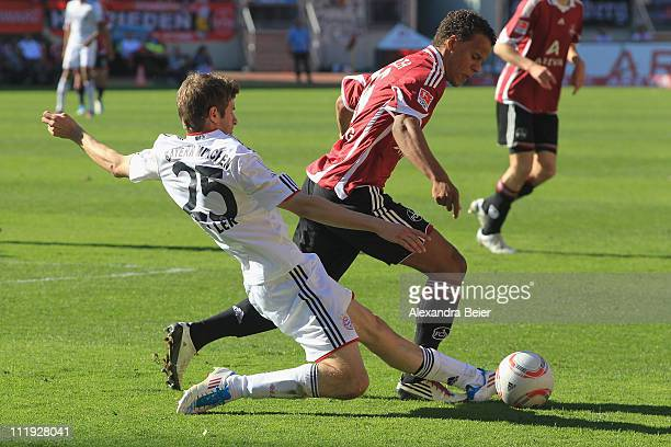 Timothy Chancdler of Nuernberg fights for the ball with Thomas Mueller of Bayern Muenchen during the Bundesliga match between 1 FC Nuernberg and FC...