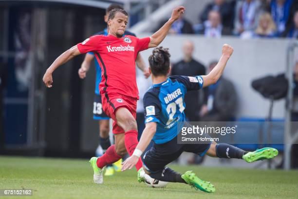 Timothy Chandler of Frankfurt is challenged by Benjamin Huebner of Hoffenheim during the Bundesliga match between TSG 1899 Hoffenheim and Eintracht...