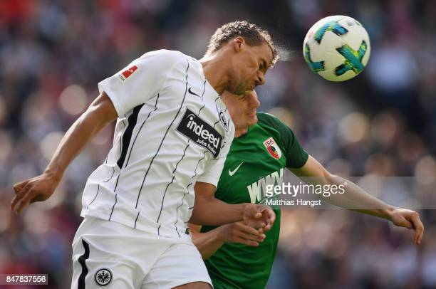 Timothy Chandler of Frankfurt jumps for a header with Martin Hinteregger of Augsburg during the Bundesliga match between Eintracht Frankfurt and FC...