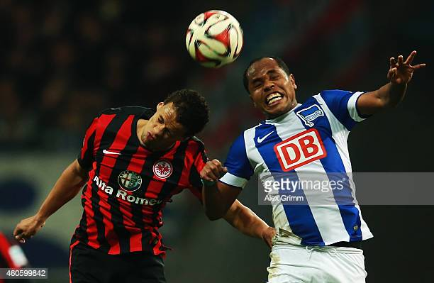 Timothy Chandler of Frankfurt jumps for a header with Ronny of Berlin during the Bundesliga match between Eintracht Frankfurt and Hertha BSC at...