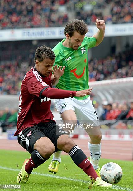 Timothy Chandler of Nuernberg and Szabolcs Huszti of Hannover compete for the ball during the Bundesliga match between 1 FC Nuernberg and Hannover 96...