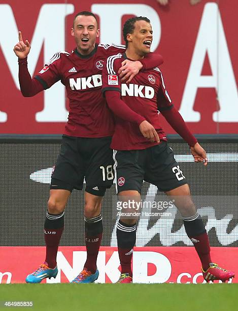Timothy Chandler of Nuernberg celebrates scoring the opening goal with his team mate Josip Drmic during the Bundesliga match between 1 FC Nuernberg...
