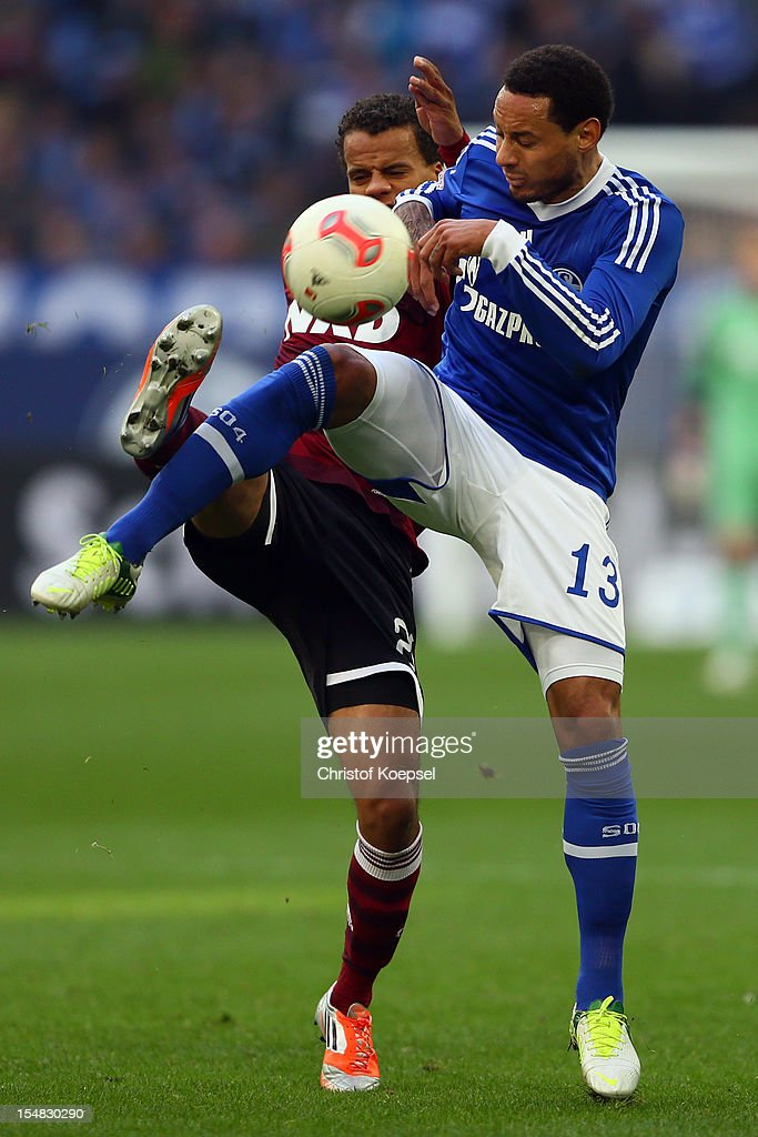 Timothy Chandler of Nuernberg challenges <a gi-track='captionPersonalityLinkClicked' href=/galleries/search?phrase=Jermaine+Jones+-+Soccer+Player&family=editorial&specificpeople=12906336 ng-click='$event.stopPropagation()'>Jermaine Jones</a> of Schalke during the Bundesliga match between FC Schalke 04 and 1. FC Nuernberg at Veltins-Arena on October 27, 2012 in Gelsenkirchen, Germany.
