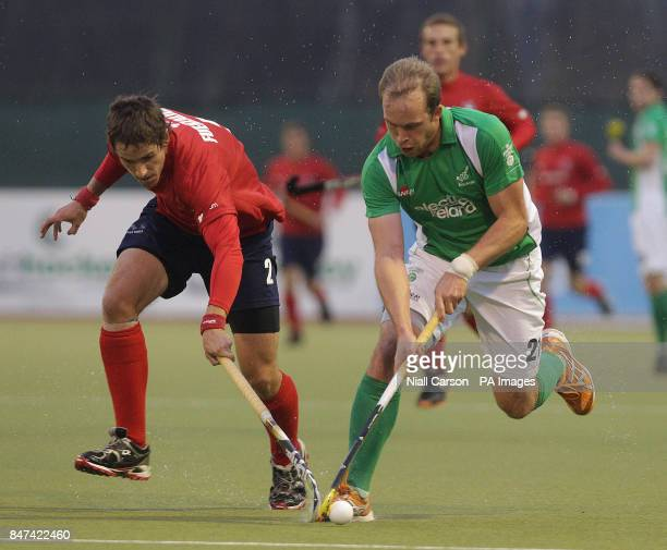 Timothy Cockram of Ireland and Andres Fuenzalida of Chile during the FIH Olympic Games Qualifying Tournament at the Belfield Dublin