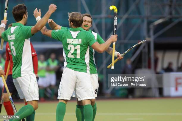 Timothy Cockram of Ireland celebrates scoring a goal with his team mates during the FIH Olympic Games Qualifying Tournament at the Belfield Dublin