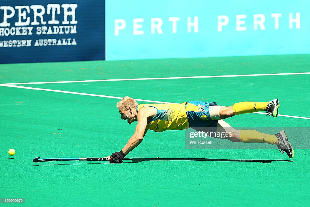 Timothy Deavin dives for the ball in the Australia v England final during day four of the 2012 International Super Series at Perth Hockey Stadium on November 25, 2012 in Perth, Australia.