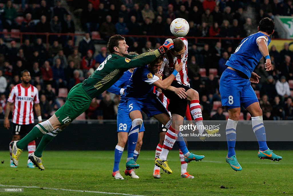 Timothy Derijck of PSV heads on goal as Goalkeeper, <a gi-track='captionPersonalityLinkClicked' href=/galleries/search?phrase=Jan+Lastuvka&family=editorial&specificpeople=2484746 ng-click='$event.stopPropagation()'>Jan Lastuvka</a>, Vitaliy Mandziuk (#5) and Victor Giuliano (#8) of Dnipro attempt to clear the ball during the UEFA Europa League Group F match between PSV Eindhoven and FC Dnipro Dnipropetrovsk at the Philips Stadion n November 22, 2012 in Eindhoven, Netherlands.