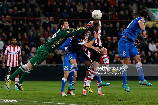 Timothy Derijck of PSV heads on goal as Goalkeeper Jan Lastuvka Vitaliy Mandziuk and Victor Giuliano of Dnipro attempt to clear the ball during the...