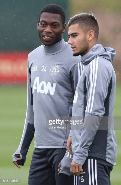 Timothy FosuMensah and Andreas Pereira of Manchester United in action during a first team training session at Aon Training Complex on August 1 2017...