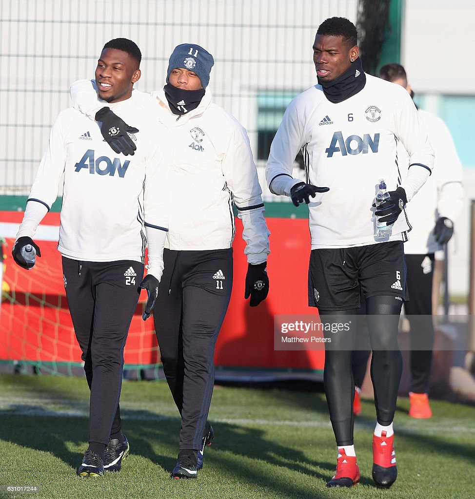 Timothy Fosu-Mensah and Anthony Martial and Paul Pogba of Manchester United in action during a first team training session at Aon Training Complex on January 5, 2017 in Manchester, England.