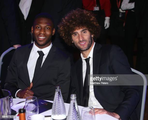 Timothy FosuMensah and Marouane Fellaini of Manchester United attend the Manchester United annual Player of the Year awards at Old Trafford on May 18...
