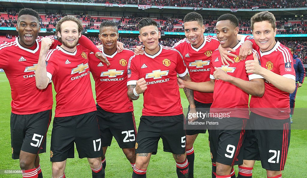 Timothy Fosu-Mensah, Daley Blind, Antonio Valencia, Marcos Rojo, Chris Smalling, Anthony Martial and Ander Herrera of Manchester United celebrate at the final whistle of the Emirates FA Cup Semi Final match between Manchester United and Everton at Wembley Stadium on April 23, 2016 in London, England.