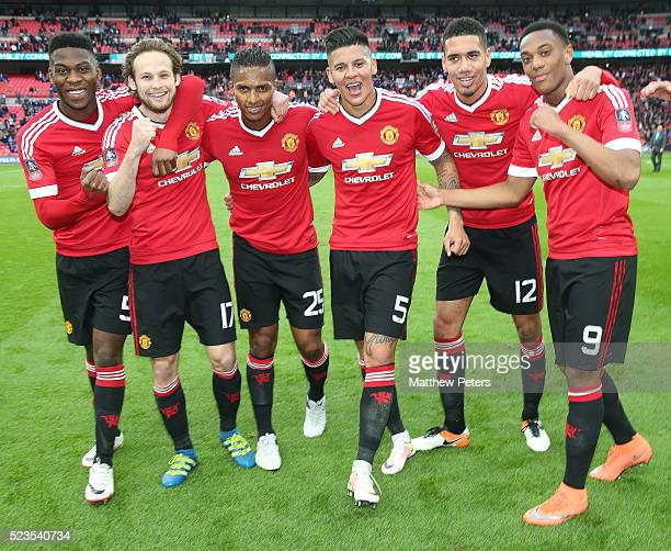 Timothy FosuMensah Daley Blind Antonio Valencia Marcos Rojo Chris Smalling and Anthony Martial of Manchester United celebrate at the final whistle of...