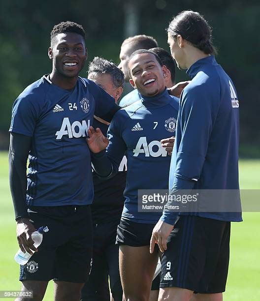 Timothy FosuMensah Memphis Depay and Zlatan Ibrahimovic of Manchester United in action during a first team training session at Aon Training Complex...