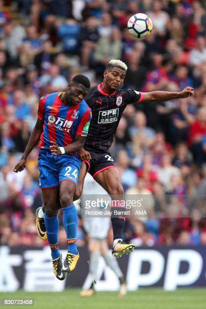 Timothy FosuMensah of Crystal Palace and Steve Mounie of Huddersfield Town during the Premier League match between Crystal Palace and Huddersfield...