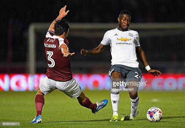 Timothy FosuMensah of Manchester United and David Buchanan of Northampton Town in action during the EFL Cup Third Round match between Northampton...