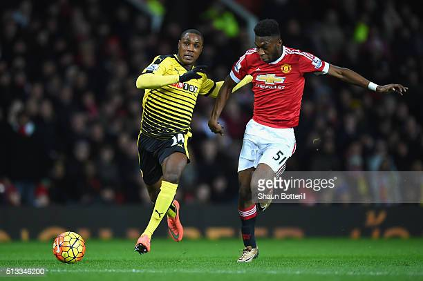 Timothy FosuMensah of Manchester United and Odion Ighalo of Watford battle for the ball during the Barclays Premier League match between Manchester...