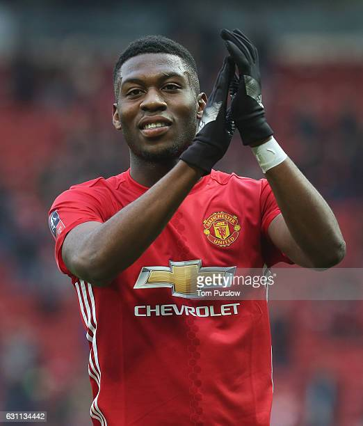Timothy FosuMensah of Manchester United applauds the fans after the Emirates FA Cup Third Round match between Manchester United and Reading at Old...