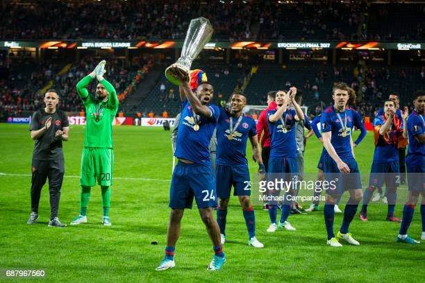 Timothy FosuMensah of Manchester United celebrates with the Europa League trophy after the UEFA Europa League final between Ajax and Manchester...