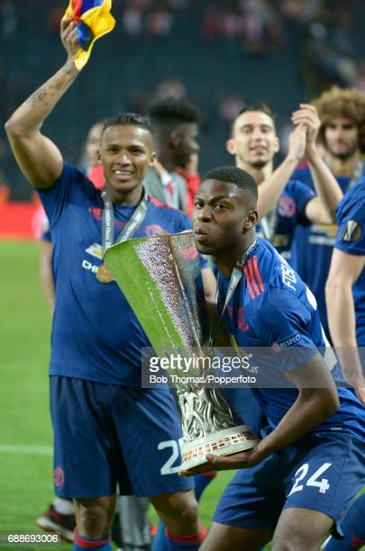 Timothy FosuMensah of Manchester United celebrates with the trophy after the UEFA Europa League final between Ajax and Manchester United at the...